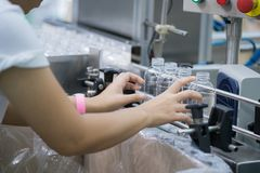 Worker in bottle plastic making working by hand in production li Royalty Free Stock Images
