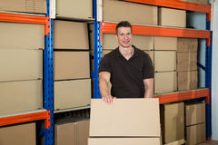 Worker With Boxes In Warehouse. Young Happy Male Worker With Boxes In Warehouse Stock Photos