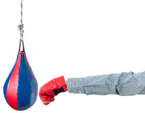 Worker with boxing glove punches punching bag Royalty Free Stock Photos