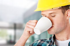 Worker on a break drinking coffee Royalty Free Stock Image