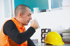 Worker on a break have rest. Worker on a break drink coffee and have rest Stock Images