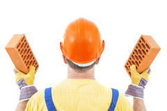Worker and Bricks in Hands Royalty Free Stock Photo