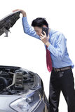 Worker with broken car calling mechanic Royalty Free Stock Image