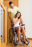 Worker brought girl in wheelchair Royalty Free Stock Photo
