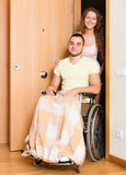 Worker brought person in wheelchair Royalty Free Stock Images