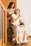 Worker brought person in wheelchair Stock Image