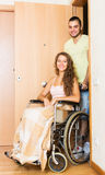 Worker brought person in wheelchair Royalty Free Stock Image