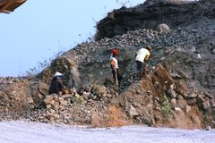 Worker at Brown rock formations Royalty Free Stock Photos