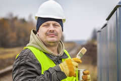 Worker with brush and paint near Royalty Free Stock Photography