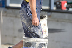 Worker with buckets Royalty Free Stock Image