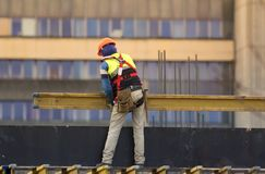 Worker build scaffolding at the construction  site Stock Images