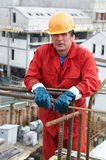 Worker builder at construction site royalty free stock photo