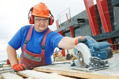 Worker builder cutting material Stock Image
