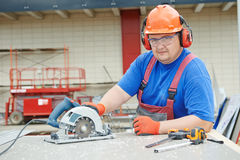 Worker builder cutting material Royalty Free Stock Photos