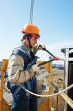 Worker builder at facade installation work with riveting hammer royalty free stock photos
