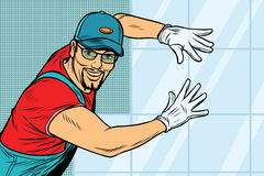Worker Builder puts tile Stock Images