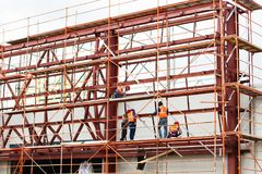 Worker builders working on roof structure on construction site.Building team. royalty free stock photo