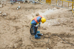 Worker at a building lot in working Stock Photos