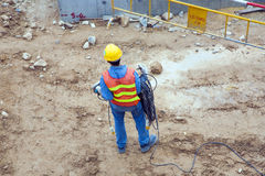 Worker at a building lot in working Royalty Free Stock Photos