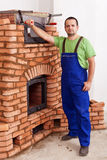 Worker building a masonry heater Royalty Free Stock Photos