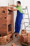 Worker building masonry heater Royalty Free Stock Image