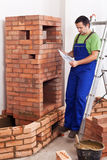 Worker building masonry heater Stock Photos