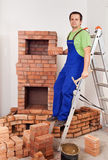 Worker building masonry heater Stock Images