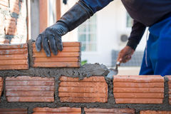 Worker building masonry house wal Stock Photography