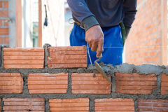 Worker building masonry house wal Royalty Free Stock Image