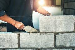 Worker building wall bricks stock image