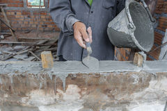 Worker building. Workers were plastering on wall in houses Stock Photo