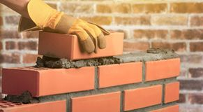 Worker builds a brick wall in the house royalty free stock images