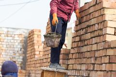 Worker builds a brick wall in the house royalty free stock photography