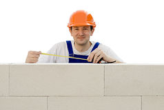 Worker builds a wall Royalty Free Stock Image