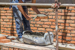 Worker built with red bricks 2 Royalty Free Stock Image