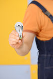 Worker with bulb Royalty Free Stock Photo