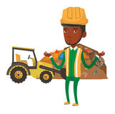 Worker and bulldozer at rubbish dump. African-american worker of rubbish dump standing with spread arms. Young man standing on the background of rubbish dump Stock Image