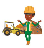 Worker and bulldozer at rubbish dump. African-american worker of rubbish dump standing with spread arms. Young woman standing on the background of rubbish dump Royalty Free Stock Images