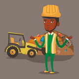 Worker and bulldozer at rubbish dump. Worker of rubbish dump standing with spread arms. Man standing on the background of rubbish dump and bulldozer. African Stock Photography