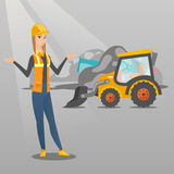 Worker and bulldozer at rubbish dump. Worker of rubbish dump standing with spread arms. Woman standing on the background of rubbish dump and bulldozer. Young Stock Images