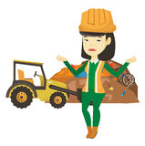 Worker and bulldozer at rubbish dump. Upset asian worker of rubbish dump. Worker of rubbish dump standing with spread arms. Woman standing on the background of Stock Photos