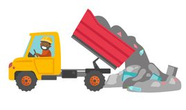 Worker and bulldozer at rubbish dump. Young african man driving a garbage truck and unloading waste on a rubbish dump. Worker dumping the rubbish on a landfill Royalty Free Stock Image