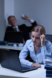 Worker bullying his work colleague. Young worker bullying his young attractive work colleague Stock Photos