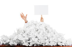 Worker buried in paperwork Stock Photos