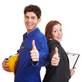 Worker and business woman holding Stock Photos