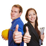 Worker and business woman holding Royalty Free Stock Photos