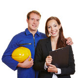 Worker and business woman in a team Stock Photos