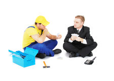 Worker and businessman Stock Photography