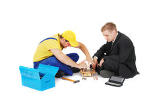 Worker and businessman Royalty Free Stock Image
