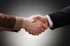 Worker and businessman shaking hand Royalty Free Stock Images